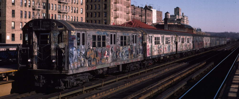 (67k, 1000x414)<br><b>Country:</b> United States<br><b>City:</b> New York<br><b>System:</b> New York City Transit<br><b>Line:</b> IRT West Side Line<br><b>Location:</b> 231st Street <br><b>Route:</b> 1<br><b>Car:</b> R-21 (St. Louis, 1956-57) 7265 <br><b>Photo by:</b> Robert Callahan<br><b>Date:</b> 2/18/1985<br><b>Viewed (this week/total):</b> 2 / 628