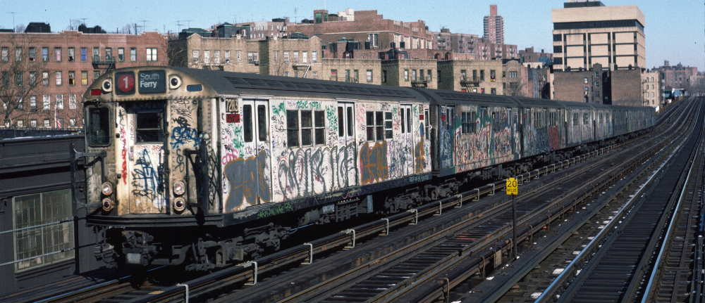 (71k, 1000x431)<br><b>Country:</b> United States<br><b>City:</b> New York<br><b>System:</b> New York City Transit<br><b>Line:</b> IRT West Side Line<br><b>Location:</b> 207th Street <br><b>Route:</b> 1<br><b>Car:</b> R-21 (St. Louis, 1956-57) 7283 <br><b>Photo by:</b> Robert Callahan<br><b>Date:</b> 2/10/1985<br><b>Viewed (this week/total):</b> 4 / 334