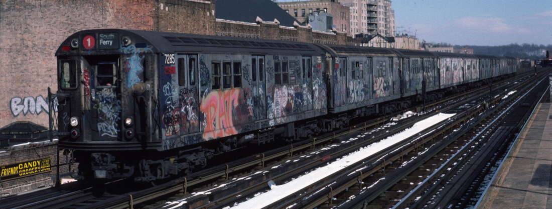(72k, 1100x418)<br><b>Country:</b> United States<br><b>City:</b> New York<br><b>System:</b> New York City Transit<br><b>Line:</b> IRT West Side Line<br><b>Location:</b> 231st Street <br><b>Route:</b> 1<br><b>Car:</b> R-21 (St. Louis, 1956-57) 7285 <br><b>Photo by:</b> Robert Callahan<br><b>Date:</b> 2/9/1985<br><b>Viewed (this week/total):</b> 1 / 551