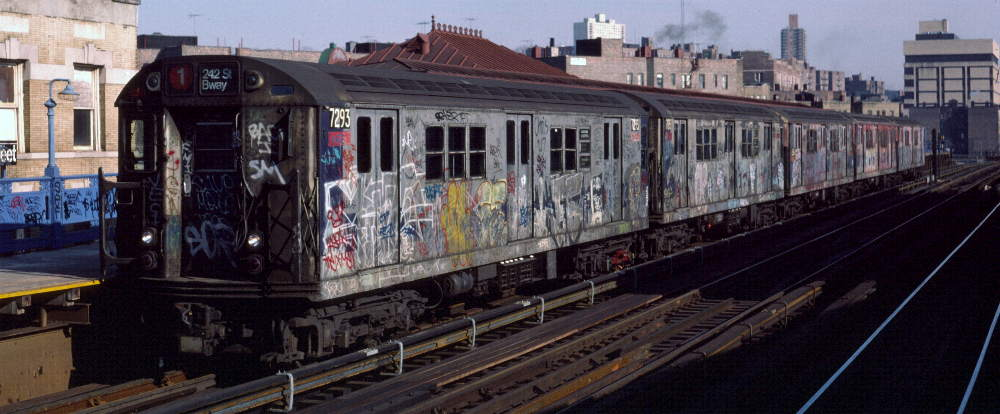 (68k, 1000x414)<br><b>Country:</b> United States<br><b>City:</b> New York<br><b>System:</b> New York City Transit<br><b>Line:</b> IRT West Side Line<br><b>Location:</b> 207th Street <br><b>Route:</b> 1<br><b>Car:</b> R-21 (St. Louis, 1956-57) 7293 <br><b>Photo by:</b> Robert Callahan<br><b>Date:</b> 2/16/1985<br><b>Viewed (this week/total):</b> 0 / 462