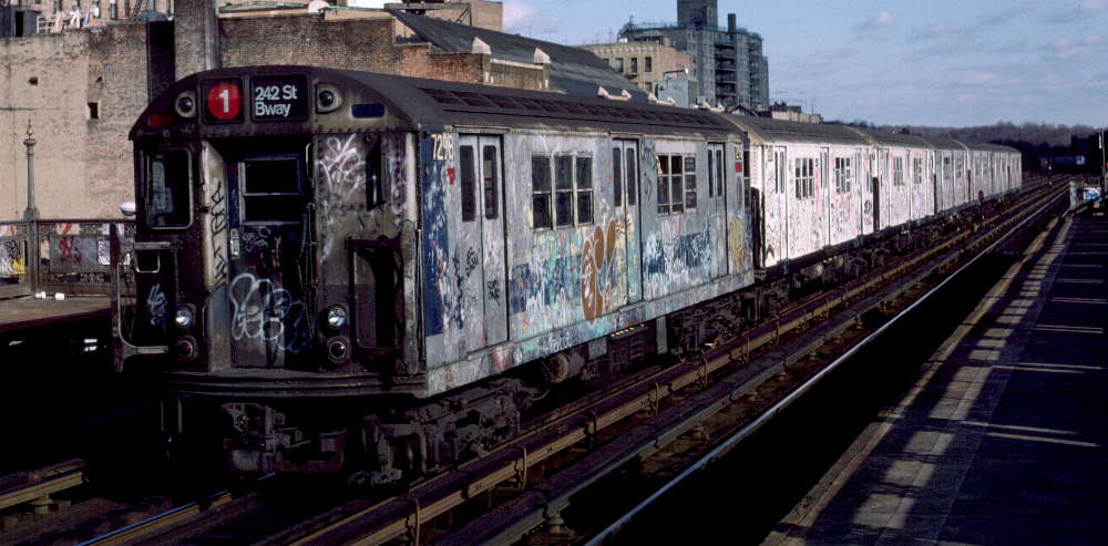 (73k, 1000x493)<br><b>Country:</b> United States<br><b>City:</b> New York<br><b>System:</b> New York City Transit<br><b>Line:</b> IRT West Side Line<br><b>Location:</b> 231st Street <br><b>Route:</b> 1<br><b>Car:</b> R-21 (St. Louis, 1956-57) 7298 <br><b>Photo by:</b> Robert Callahan<br><b>Date:</b> 11/17/1984<br><b>Viewed (this week/total):</b> 1 / 606