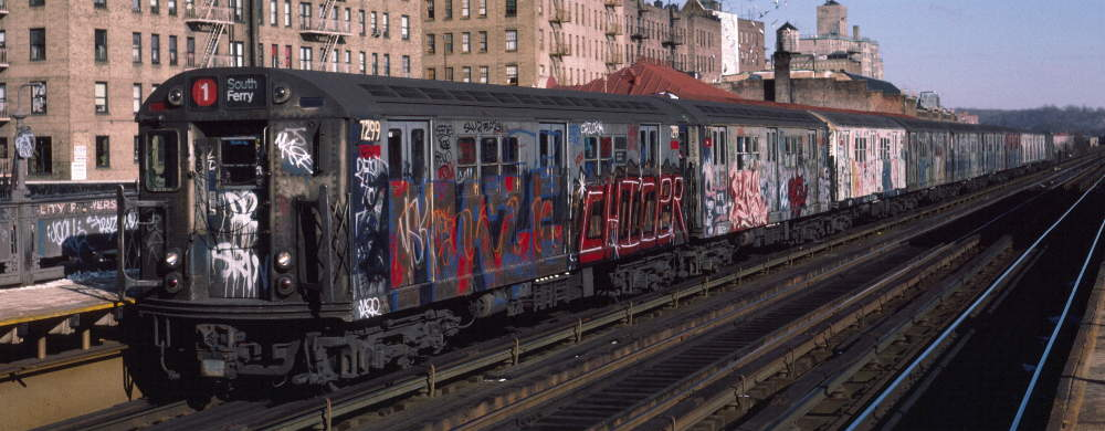 (68k, 1000x390)<br><b>Country:</b> United States<br><b>City:</b> New York<br><b>System:</b> New York City Transit<br><b>Line:</b> IRT West Side Line<br><b>Location:</b> 231st Street <br><b>Route:</b> 1<br><b>Car:</b> R-21 (St. Louis, 1956-57) 7299 <br><b>Photo by:</b> Robert Callahan<br><b>Date:</b> 1/12/1985<br><b>Viewed (this week/total):</b> 1 / 396