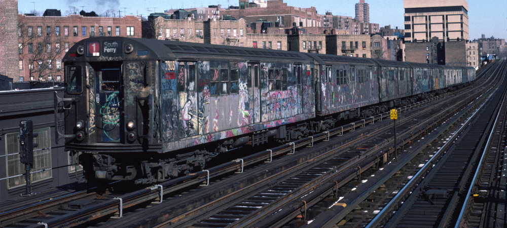 (68k, 1000x450)<br><b>Country:</b> United States<br><b>City:</b> New York<br><b>System:</b> New York City Transit<br><b>Line:</b> IRT West Side Line<br><b>Location:</b> 207th Street <br><b>Route:</b> 1<br><b>Car:</b> R-22 (St. Louis, 1957-58) 7303 <br><b>Photo by:</b> Robert Callahan<br><b>Date:</b> 2/10/1985<br><b>Viewed (this week/total):</b> 1 / 754