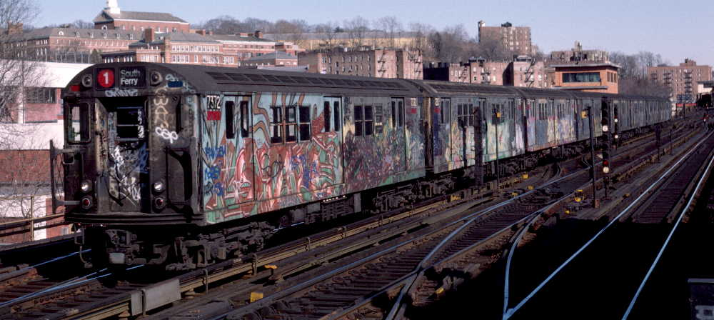 (66k, 1000x448)<br><b>Country:</b> United States<br><b>City:</b> New York<br><b>System:</b> New York City Transit<br><b>Line:</b> IRT West Side Line<br><b>Location:</b> 238th Street <br><b>Route:</b> 1<br><b>Car:</b> R-22 (St. Louis, 1957-58) 7372 <br><b>Photo by:</b> Robert Callahan<br><b>Date:</b> 2/18/1985<br><b>Viewed (this week/total):</b> 1 / 689