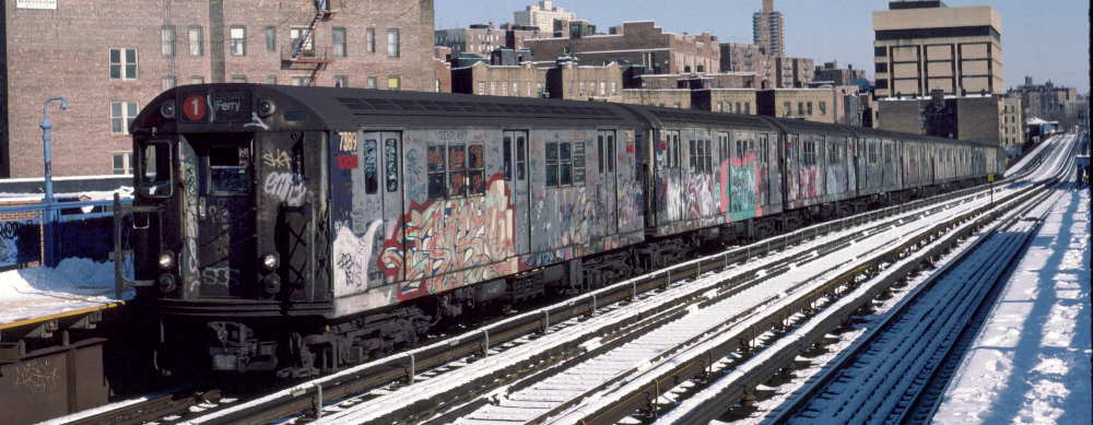 (69k, 1000x389)<br><b>Country:</b> United States<br><b>City:</b> New York<br><b>System:</b> New York City Transit<br><b>Line:</b> IRT West Side Line<br><b>Location:</b> 207th Street <br><b>Route:</b> 1<br><b>Car:</b> R-22 (St. Louis, 1957-58) 7389 <br><b>Photo by:</b> Robert Callahan<br><b>Date:</b> 2/3/1985<br><b>Viewed (this week/total):</b> 0 / 754