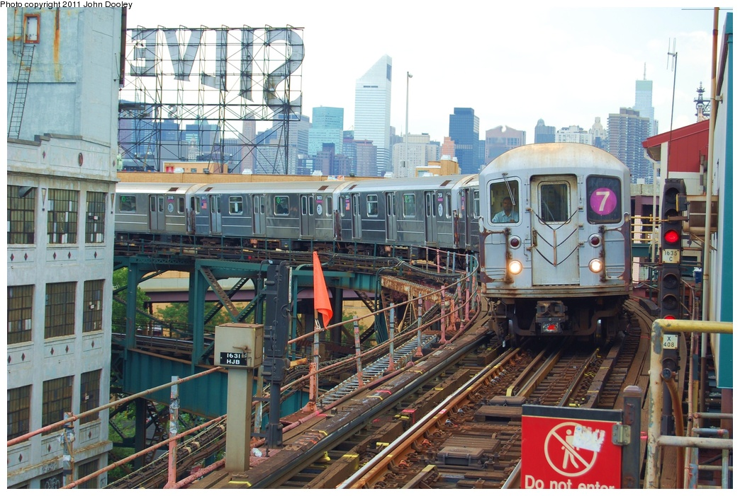 (369k, 1044x701)<br><b>Country:</b> United States<br><b>City:</b> New York<br><b>System:</b> New York City Transit<br><b>Line:</b> IRT Flushing Line<br><b>Location:</b> Queensborough Plaza <br><b>Route:</b> 7<br><b>Car:</b> R-62A (Bombardier, 1984-1987)  2111 <br><b>Photo by:</b> John Dooley<br><b>Date:</b> 6/27/2011<br><b>Viewed (this week/total):</b> 2 / 767