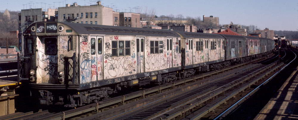 (64k, 1000x403)<br><b>Country:</b> United States<br><b>City:</b> New York<br><b>System:</b> New York City Transit<br><b>Line:</b> IRT West Side Line<br><b>Location:</b> 238th Street <br><b>Route:</b> 1<br><b>Car:</b> R-29 (St. Louis, 1962) 8612 <br><b>Photo by:</b> Robert Callahan<br><b>Date:</b> 2/18/1985<br><b>Viewed (this week/total):</b> 8 / 345