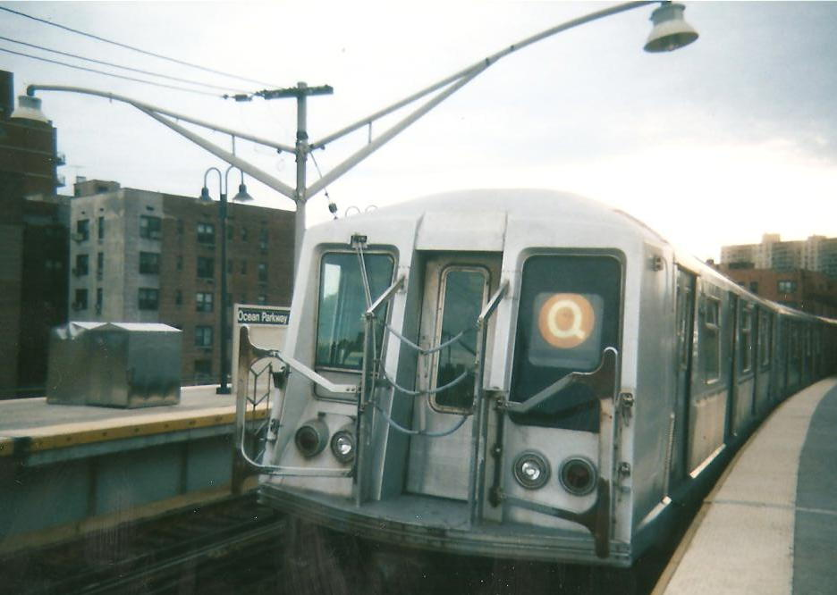 (68k, 936x666)<br><b>Country:</b> United States<br><b>City:</b> New York<br><b>System:</b> New York City Transit<br><b>Line:</b> BMT Brighton Line<br><b>Location:</b> Ocean Parkway <br><b>Route:</b> Q yard move<br><b>Car:</b> R-40 (St. Louis, 1968)   <br><b>Photo by:</b> Zach Summer<br><b>Date:</b> 1999<br><b>Notes:</b> Summer 1999<br><b>Viewed (this week/total):</b> 0 / 530