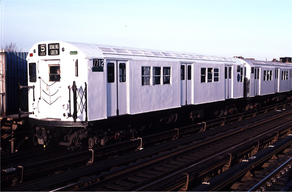 (167k, 1024x674)<br><b>Country:</b> United States<br><b>City:</b> New York<br><b>System:</b> New York City Transit<br><b>Line:</b> IRT White Plains Road Line<br><b>Location:</b> Intervale Avenue <br><b>Route:</b> 5<br><b>Car:</b> R-22 (St. Louis, 1957-58) 7712 <br><b>Photo by:</b> Doug Grotjahn<br><b>Collection of:</b> Joe Testagrose<br><b>Date:</b> 1/8/1983<br><b>Viewed (this week/total):</b> 5 / 481