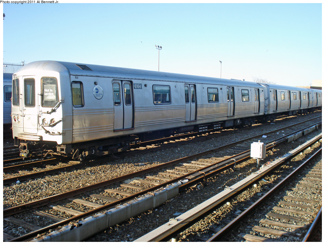 (500k, 1044x788)<br><b>Country:</b> United States<br><b>City:</b> New York<br><b>System:</b> New York City Transit<br><b>Location:</b> Rockaway Park Yard<br><b>Car:</b> R-46 (Pullman-Standard, 1974-75) 6164 <br><b>Photo by:</b> Al Bennett, Jr.<br><b>Date:</b> 4/21/2011<br><b>Viewed (this week/total):</b> 5 / 296
