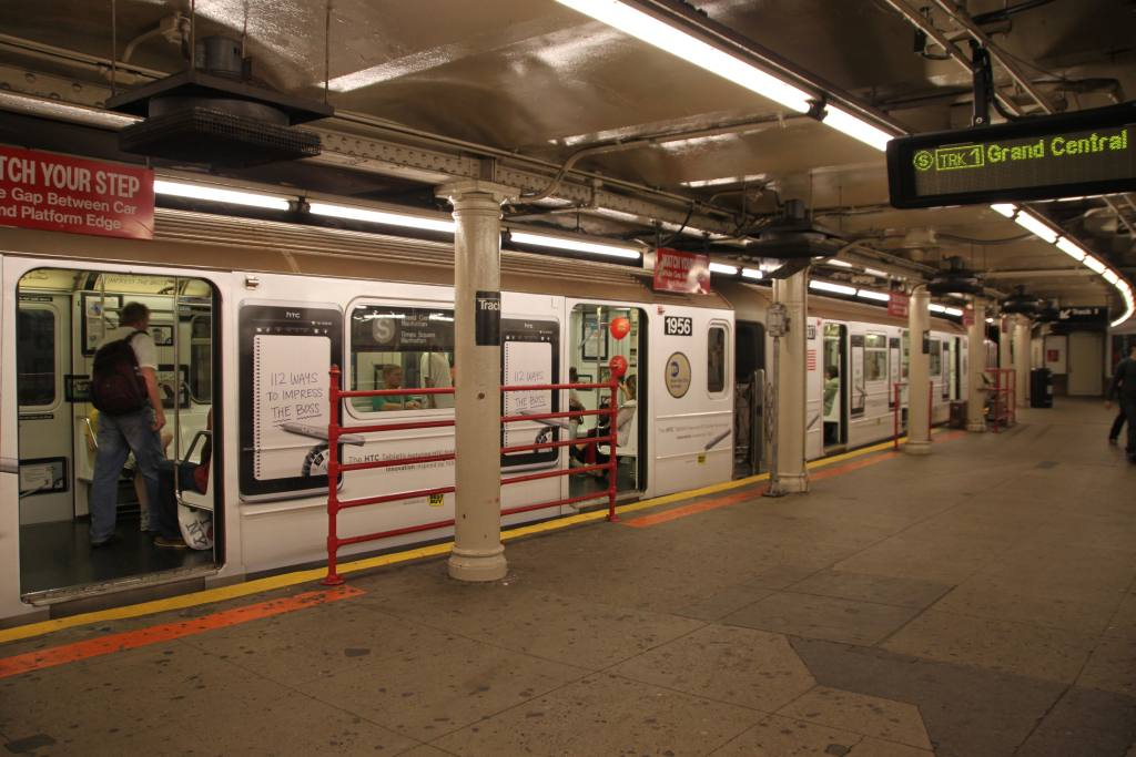 (107k, 1024x683)<br><b>Country:</b> United States<br><b>City:</b> New York<br><b>System:</b> New York City Transit<br><b>Line:</b> IRT Times Square-Grand Central Shuttle<br><b>Location:</b> Times Square <br><b>Route:</b> S<br><b>Car:</b> R-62A (Bombardier, 1984-1987)  1956 <br><b>Photo by:</b> Robbie Rosenfeld<br><b>Date:</b> 9/11/2011<br><b>Notes:</b> HTC ad wrap.<br><b>Viewed (this week/total):</b> 3 / 849