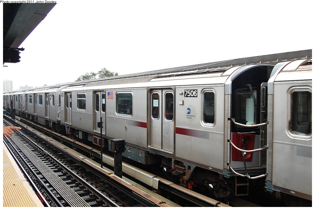 (304k, 1044x696)<br><b>Country:</b> United States<br><b>City:</b> New York<br><b>System:</b> New York City Transit<br><b>Line:</b> IRT Flushing Line<br><b>Location:</b> Willets Point/Mets (fmr. Shea Stadium) <br><b>Route:</b> Testing<br><b>Car:</b> R-142A (Primary Order, Kawasaki, 1999-2002)  7506 <br><b>Photo by:</b> John Dooley<br><b>Date:</b> 9/20/2011<br><b>Viewed (this week/total):</b> 3 / 406