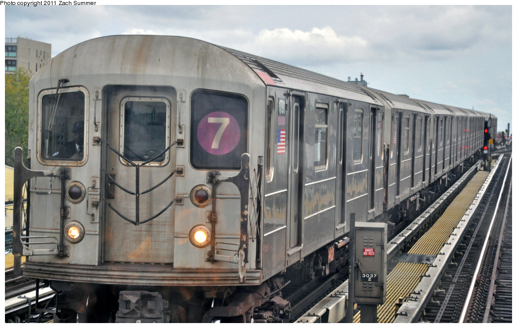 (343k, 1044x663)<br><b>Country:</b> United States<br><b>City:</b> New York<br><b>System:</b> New York City Transit<br><b>Line:</b> IRT Flushing Line<br><b>Location:</b> 69th Street/Fisk Avenue <br><b>Route:</b> 7<br><b>Car:</b> R-62A (Bombardier, 1984-1987)  1791 <br><b>Photo by:</b> Zach Summer<br><b>Date:</b> 10/12/2011<br><b>Viewed (this week/total):</b> 2 / 519