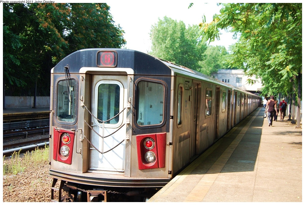 (390k, 1044x701)<br><b>Country:</b> United States<br><b>City:</b> New York<br><b>System:</b> New York City Transit<br><b>Line:</b> IRT Dyre Ave. Line<br><b>Location:</b> Gun Hill Road <br><b>Route:</b> 5<br><b>Car:</b> R-142 (Primary Order, Bombardier, 1999-2002)  6911 <br><b>Photo by:</b> John Dooley<br><b>Date:</b> 6/28/2011<br><b>Viewed (this week/total):</b> 2 / 337