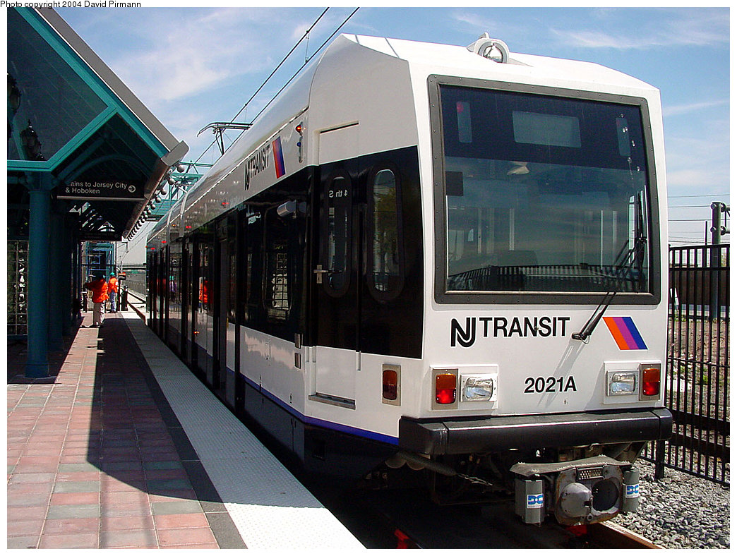 (277k, 1044x788)<br><b>Country:</b> United States<br><b>City:</b> Bayonne, NJ<br><b>System:</b> Hudson Bergen Light Rail<br><b>Location:</b> East 34th Street <br><b>Car:</b> NJT-HBLR LRV (Kinki-Sharyo, 1998-99)  2021 <br><b>Photo by:</b> David Pirmann<br><b>Date:</b> 4/29/2000<br><b>Viewed (this week/total):</b> 1 / 2744