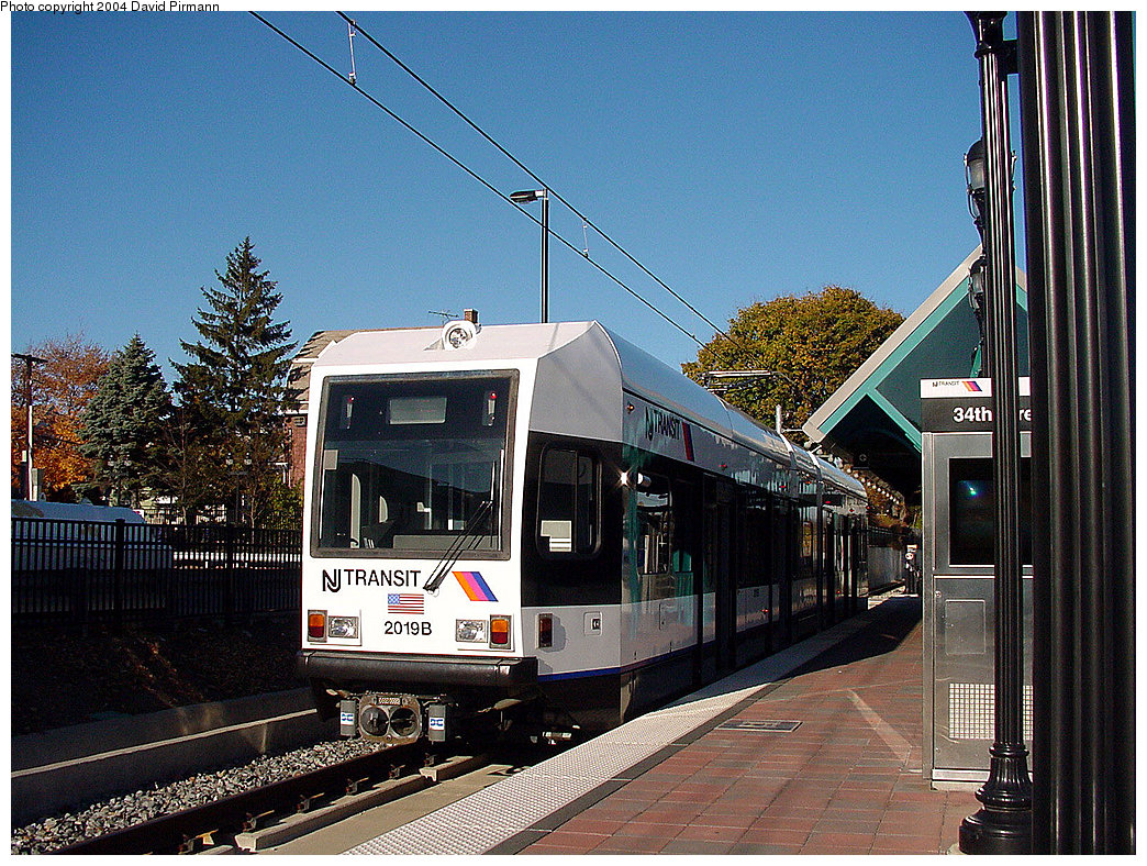(343k, 1044x788)<br><b>Country:</b> United States<br><b>City:</b> Bayonne, NJ<br><b>System:</b> Hudson Bergen Light Rail<br><b>Location:</b> East 34th Street <br><b>Car:</b> NJT-HBLR LRV (Kinki-Sharyo, 1998-99)  2019 <br><b>Photo by:</b> David Pirmann<br><b>Date:</b> 11/11/2001<br><b>Viewed (this week/total):</b> 0 / 3258