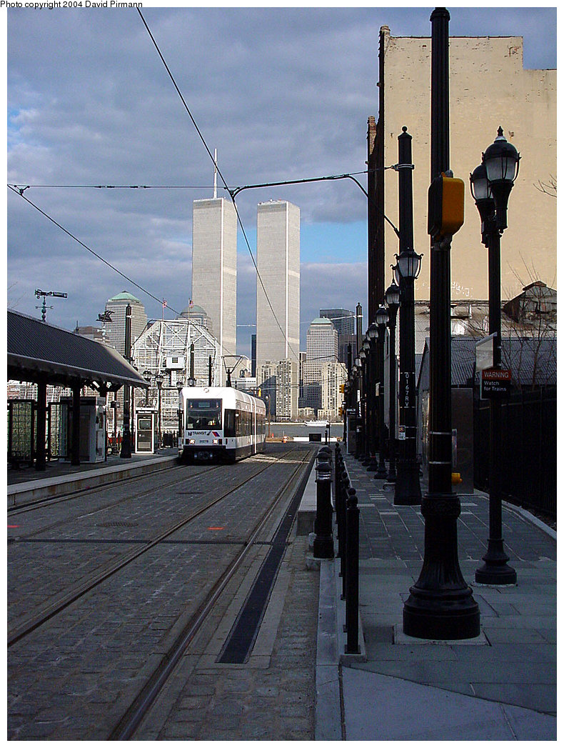 (274k, 790x1047)<br><b>Country:</b> United States<br><b>City:</b> Jersey City, NJ<br><b>System:</b> Hudson Bergen Light Rail<br><b>Location:</b> Essex Street <br><b>Car:</b> NJT-HBLR LRV (Kinki-Sharyo, 1998-99)  2027 <br><b>Photo by:</b> David Pirmann<br><b>Date:</b> 3/26/2000<br><b>Viewed (this week/total):</b> 1 / 6973