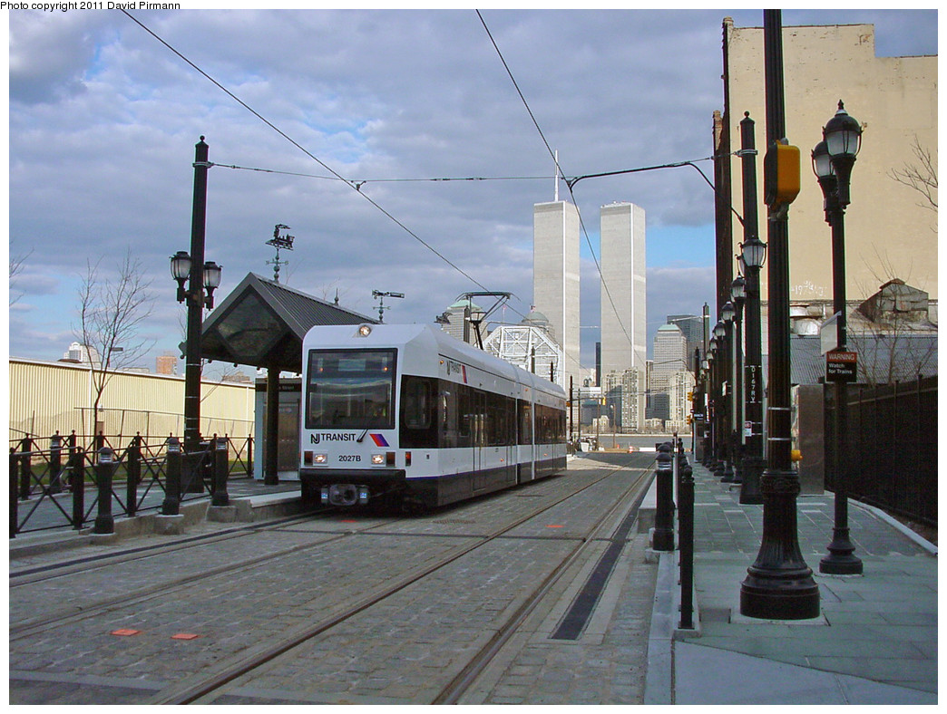 (300k, 1044x788)<br><b>Country:</b> United States<br><b>City:</b> Jersey City, NJ<br><b>System:</b> Hudson Bergen Light Rail<br><b>Location:</b> Essex Street <br><b>Car:</b> NJT-HBLR LRV (Kinki-Sharyo, 1998-99)  2027 <br><b>Photo by:</b> David Pirmann<br><b>Date:</b> 3/26/2000<br><b>Viewed (this week/total):</b> 5 / 27193