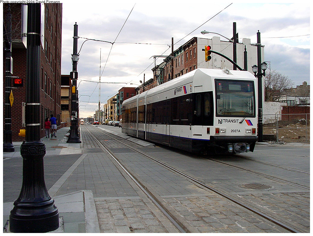 (273k, 1044x788)<br><b>Country:</b> United States<br><b>City:</b> Jersey City, NJ<br><b>System:</b> Hudson Bergen Light Rail<br><b>Location:</b> Essex Street <br><b>Car:</b> NJT-HBLR LRV (Kinki-Sharyo, 1998-99)  2027 <br><b>Photo by:</b> David Pirmann<br><b>Date:</b> 3/26/2000<br><b>Viewed (this week/total):</b> 3 / 2421