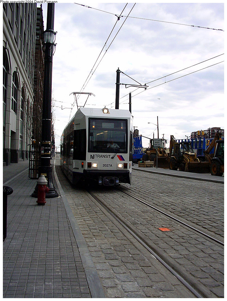 (270k, 790x1047)<br><b>Country:</b> United States<br><b>City:</b> Jersey City, NJ<br><b>System:</b> Hudson Bergen Light Rail<br><b>Location:</b> Exchange Place <br><b>Car:</b> NJT-HBLR LRV (Kinki-Sharyo, 1998-99)  2027 <br><b>Photo by:</b> David Pirmann<br><b>Date:</b> 3/26/2000<br><b>Viewed (this week/total):</b> 0 / 1896
