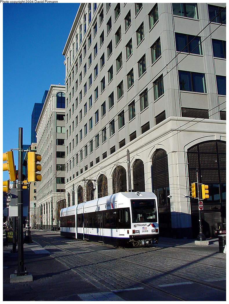 (345k, 790x1047)<br><b>Country:</b> United States<br><b>City:</b> Jersey City, NJ<br><b>System:</b> Hudson Bergen Light Rail<br><b>Location:</b> Exchange Place <br><b>Car:</b> NJT-HBLR LRV (Kinki-Sharyo, 1998-99)  2020 <br><b>Photo by:</b> David Pirmann<br><b>Date:</b> 11/11/2001<br><b>Viewed (this week/total):</b> 0 / 2547