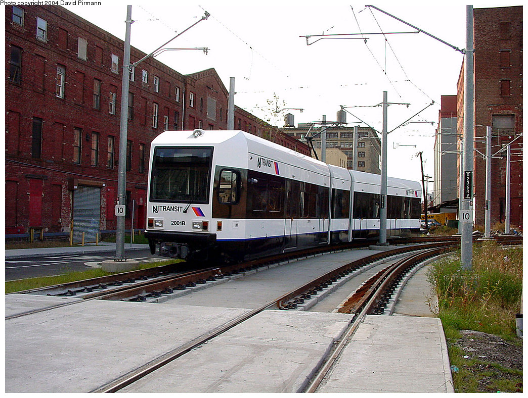 (301k, 1044x788)<br><b>Country:</b> United States<br><b>City:</b> Jersey City, NJ<br><b>System:</b> Hudson Bergen Light Rail<br><b>Location:</b> Harsimus Cove <br><b>Car:</b> NJT-HBLR LRV (Kinki-Sharyo, 1998-99)  2001 <br><b>Photo by:</b> David Pirmann<br><b>Date:</b> 11/12/2000<br><b>Notes:</b> Washington Blvd. grade crossing<br><b>Viewed (this week/total):</b> 0 / 2721