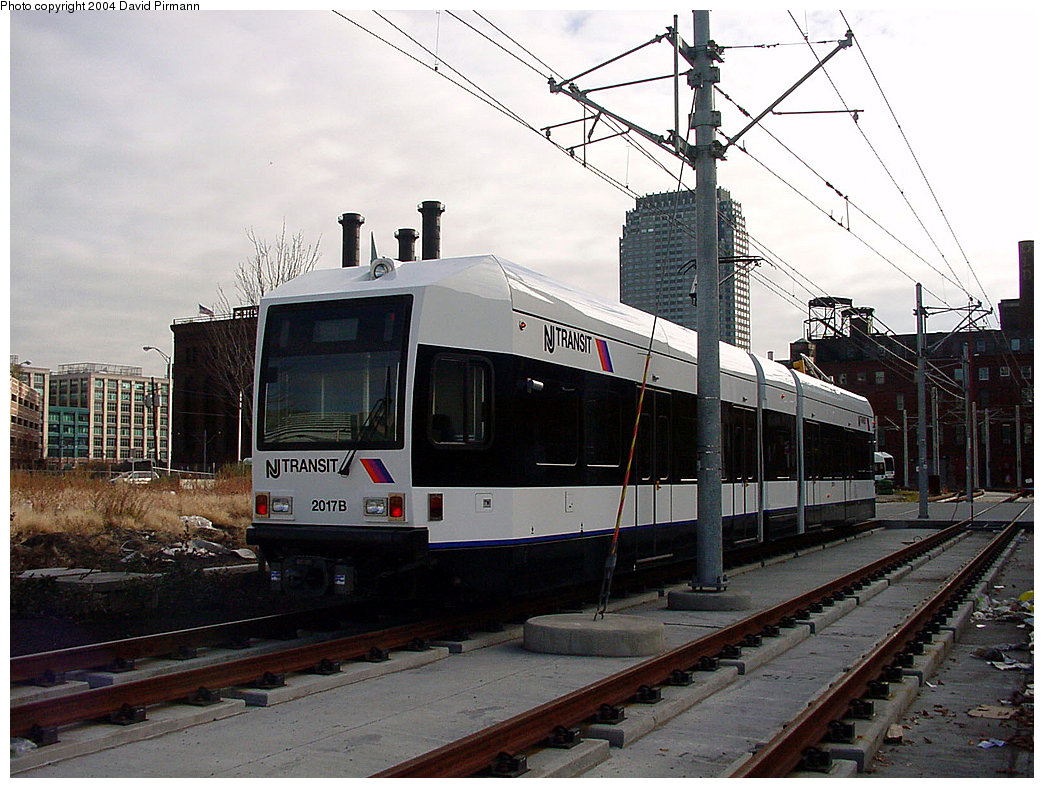 (244k, 1044x788)<br><b>Country:</b> United States<br><b>City:</b> Jersey City, NJ<br><b>System:</b> Hudson Bergen Light Rail<br><b>Location:</b> Harsimus Cove <br><b>Car:</b> NJT-HBLR LRV (Kinki-Sharyo, 1998-99)  2017 <br><b>Photo by:</b> David Pirmann<br><b>Date:</b> 11/12/2000<br><b>Notes:</b> 2nd St. grade crossing<br><b>Viewed (this week/total):</b> 0 / 1999
