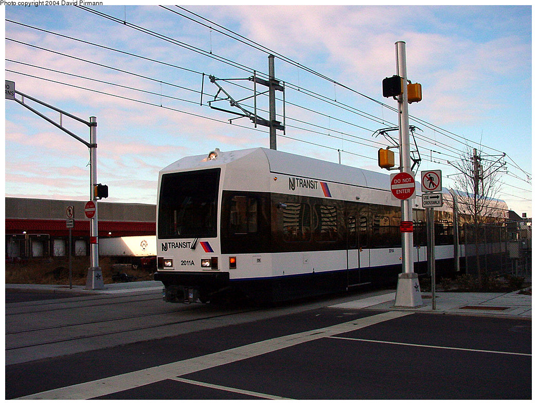 (286k, 1044x788)<br><b>Country:</b> United States<br><b>City:</b> Jersey City, NJ<br><b>System:</b> Hudson Bergen Light Rail<br><b>Location:</b> Harsimus Cove <br><b>Car:</b> NJT-HBLR LRV (Kinki-Sharyo, 1998-99)  2011 <br><b>Photo by:</b> David Pirmann<br><b>Date:</b> 11/12/2000<br><b>Notes:</b> 2nd St. grade crossing<br><b>Viewed (this week/total):</b> 2 / 2435