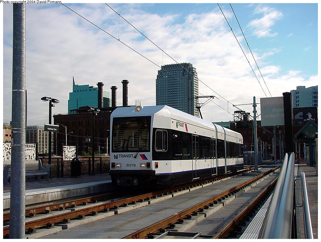 (271k, 1044x788)<br><b>Country:</b> United States<br><b>City:</b> Jersey City, NJ<br><b>System:</b> Hudson Bergen Light Rail<br><b>Location:</b> Harsimus Cove <br><b>Car:</b> NJT-HBLR LRV (Kinki-Sharyo, 1998-99)  2027 <br><b>Photo by:</b> David Pirmann<br><b>Date:</b> 11/12/2000<br><b>Viewed (this week/total):</b> 0 / 2161