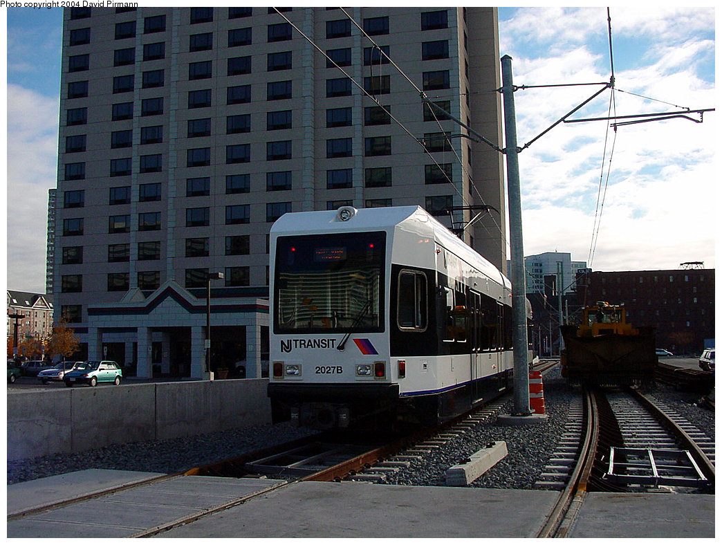 (267k, 1044x788)<br><b>Country:</b> United States<br><b>City:</b> Jersey City, NJ<br><b>System:</b> Hudson Bergen Light Rail<br><b>Location:</b> Harsimus Cove <br><b>Car:</b> NJT-HBLR LRV (Kinki-Sharyo, 1998-99)  2027 <br><b>Photo by:</b> David Pirmann<br><b>Date:</b> 11/12/2000<br><b>Notes:</b> 6th St. grade crossing facing Harsimus Cove<br><b>Viewed (this week/total):</b> 0 / 2361