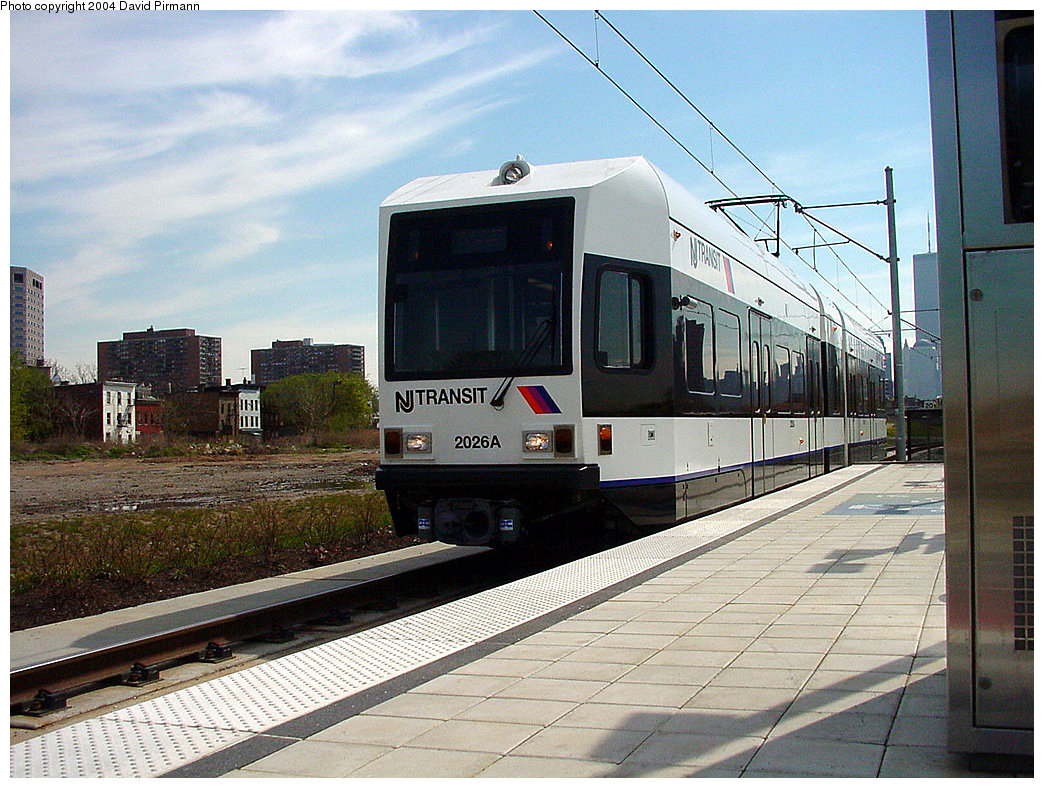 (286k, 1044x788)<br><b>Country:</b> United States<br><b>City:</b> Jersey City, NJ<br><b>System:</b> Hudson Bergen Light Rail<br><b>Location:</b> Jersey Avenue <br><b>Car:</b> NJT-HBLR LRV (Kinki-Sharyo, 1998-99)  2026 <br><b>Photo by:</b> David Pirmann<br><b>Date:</b> 4/29/2000<br><b>Viewed (this week/total):</b> 2 / 2320