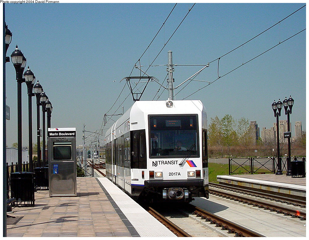 (279k, 1044x814)<br><b>Country:</b> United States<br><b>City:</b> Jersey City, NJ<br><b>System:</b> Hudson Bergen Light Rail<br><b>Location:</b> Marin Boulevard <br><b>Car:</b> NJT-HBLR LRV (Kinki-Sharyo, 1998-99)  2017 <br><b>Photo by:</b> David Pirmann<br><b>Date:</b> 4/29/2000<br><b>Viewed (this week/total):</b> 1 / 2420