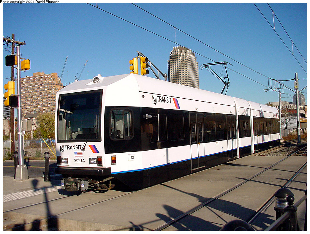 (278k, 1044x788)<br><b>Country:</b> United States<br><b>City:</b> Jersey City, NJ<br><b>System:</b> Hudson Bergen Light Rail<br><b>Location:</b> Marin Boulevard <br><b>Car:</b> NJT-HBLR LRV (Kinki-Sharyo, 1998-99)  2021 <br><b>Photo by:</b> David Pirmann<br><b>Date:</b> 11/11/2001<br><b>Viewed (this week/total):</b> 1 / 2817