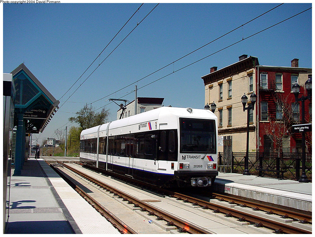 (305k, 1044x788)<br><b>Country:</b> United States<br><b>City:</b> Jersey City, NJ<br><b>System:</b> Hudson Bergen Light Rail<br><b>Location:</b> Martin Luther King Drive <br><b>Car:</b> NJT-HBLR LRV (Kinki-Sharyo, 1998-99)  2026 <br><b>Photo by:</b> David Pirmann<br><b>Date:</b> 4/29/2000<br><b>Viewed (this week/total):</b> 0 / 4404