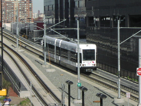 (82k, 600x450)<br><b>Country:</b> United States<br><b>City:</b> Jersey City, NJ<br><b>System:</b> Hudson Bergen Light Rail<br><b>Location:</b> Pavonia/Newport <br><b>Car:</b> NJT-HBLR LRV (Kinki-Sharyo, 1998-99)  2027 <br><b>Photo by:</b> Trevor Logan<br><b>Date:</b> 11/17/2001<br><b>Notes:</b> On Newport Viaduct near Newport station<br><b>Viewed (this week/total):</b> 0 / 3165
