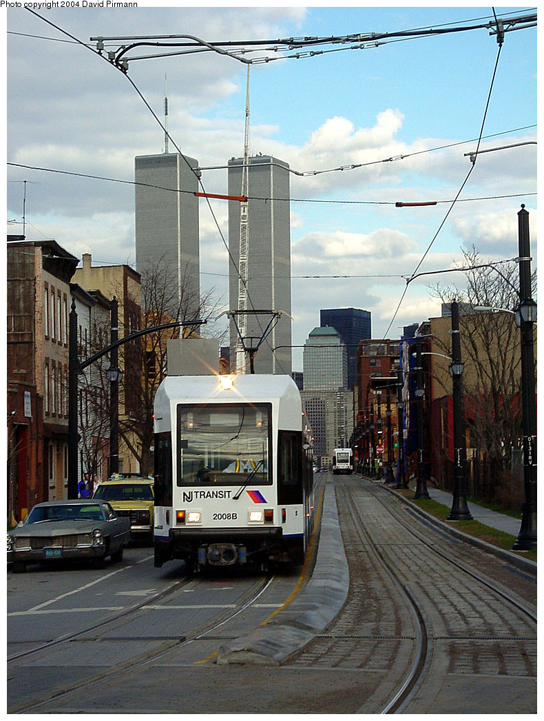 (276k, 790x1047)<br><b>Country:</b> United States<br><b>City:</b> Jersey City, NJ<br><b>System:</b> Hudson Bergen Light Rail<br><b>Location:</b> Van Vorst Street <br><b>Car:</b> NJT-HBLR LRV (Kinki-Sharyo, 1998-99)  2008 <br><b>Photo by:</b> David Pirmann<br><b>Date:</b> 3/26/2000<br><b>Viewed (this week/total):</b> 0 / 6799