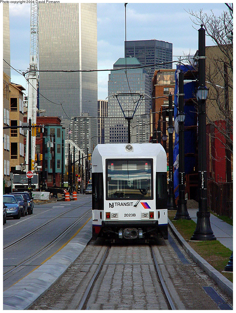 (346k, 790x1047)<br><b>Country:</b> United States<br><b>City:</b> Jersey City, NJ<br><b>System:</b> Hudson Bergen Light Rail<br><b>Location:</b> Van Vorst Street <br><b>Car:</b> NJT-HBLR LRV (Kinki-Sharyo, 1998-99)  2023 <br><b>Photo by:</b> David Pirmann<br><b>Date:</b> 3/26/2000<br><b>Viewed (this week/total):</b> 0 / 9311