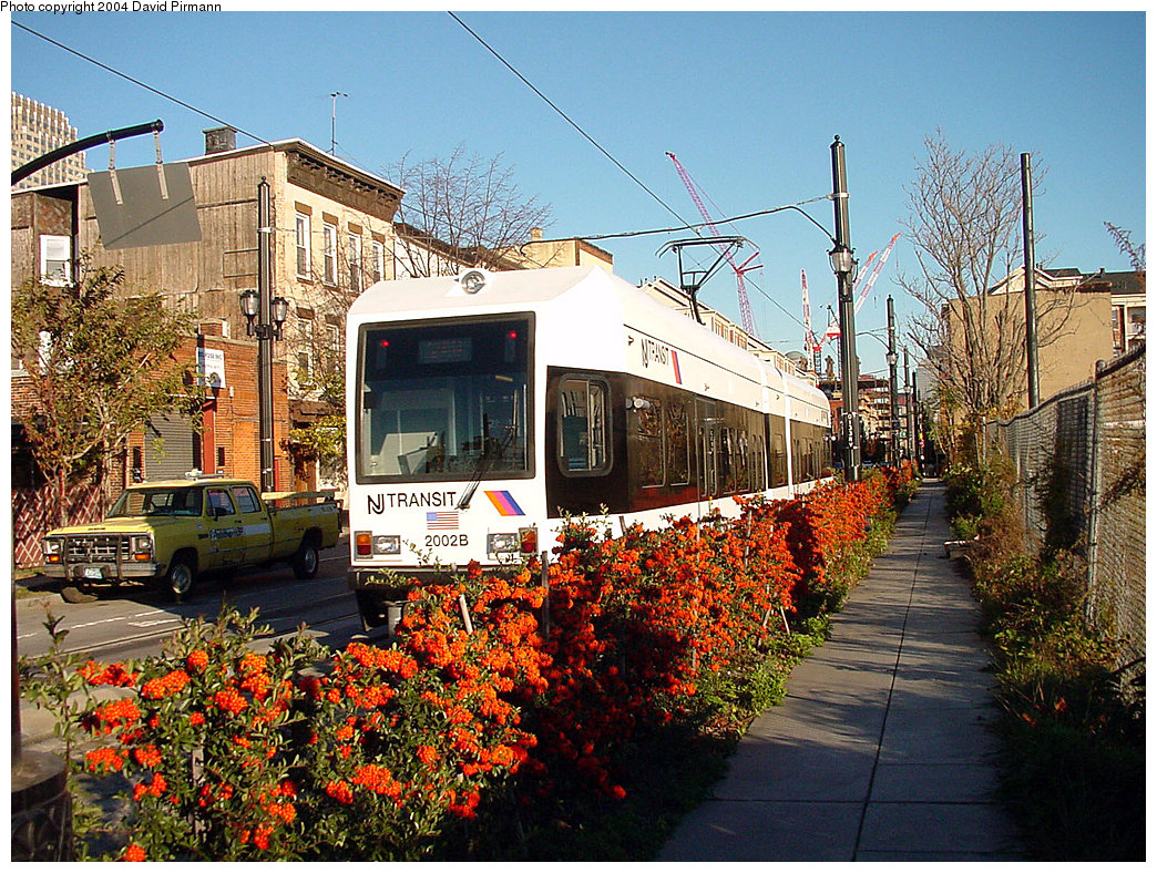 (388k, 1044x788)<br><b>Country:</b> United States<br><b>City:</b> Jersey City, NJ<br><b>System:</b> Hudson Bergen Light Rail<br><b>Location:</b> Van Vorst Street <br><b>Car:</b> NJT-HBLR LRV (Kinki-Sharyo, 1998-99)  2002 <br><b>Photo by:</b> David Pirmann<br><b>Date:</b> 11/11/2001<br><b>Viewed (this week/total):</b> 3 / 3506