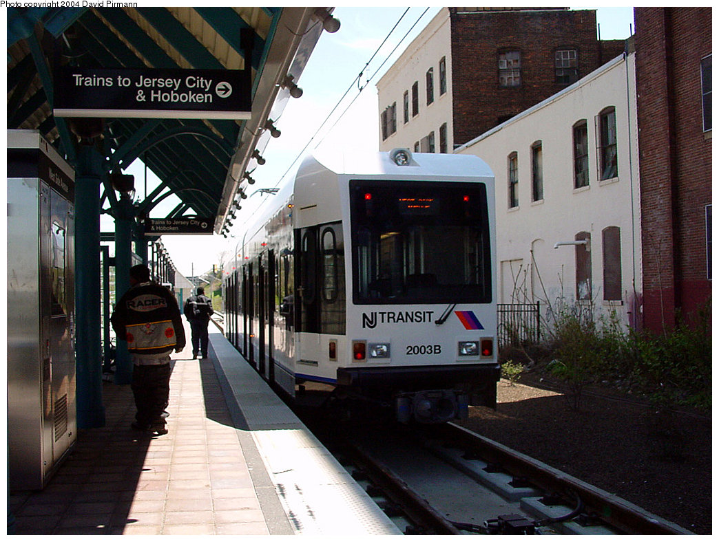 (254k, 1044x788)<br><b>Country:</b> United States<br><b>City:</b> Jersey City, NJ<br><b>System:</b> Hudson Bergen Light Rail<br><b>Location:</b> West Side Avenue <br><b>Car:</b> NJT-HBLR LRV (Kinki-Sharyo, 1998-99)  2003 <br><b>Photo by:</b> David Pirmann<br><b>Date:</b> 4/29/2000<br><b>Viewed (this week/total):</b> 0 / 3253