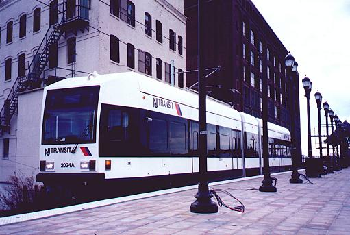 (38k, 511x343)<br><b>Country:</b> United States<br><b>City:</b> Jersey City, NJ<br><b>System:</b> Hudson Bergen Light Rail<br><b>Location:</b> West Side Avenue <br><b>Car:</b> NJT-HBLR LRV (Kinki-Sharyo, 1998-99)  2024 <br><b>Photo by:</b> Trevor Logan<br><b>Date:</b> 2000<br><b>Viewed (this week/total):</b> 0 / 3295