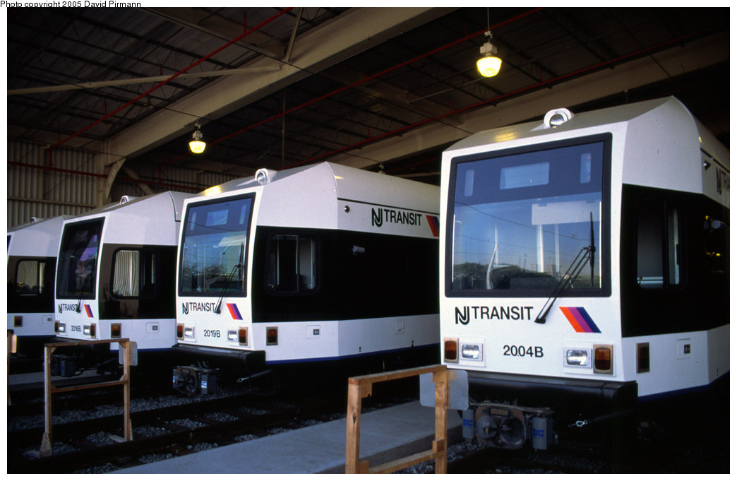 (150k, 1044x681)<br><b>Country:</b> United States<br><b>City:</b> Jersey City, NJ<br><b>System:</b> Hudson Bergen Light Rail<br><b>Location:</b> HBLR Shops/Yard <br><b>Car:</b> NJT-HBLR LRV (Kinki-Sharyo, 1998-99)  2016/2019/2004 <br><b>Photo by:</b> David Pirmann<br><b>Date:</b> 10/2/1999<br><b>Viewed (this week/total):</b> 0 / 2697