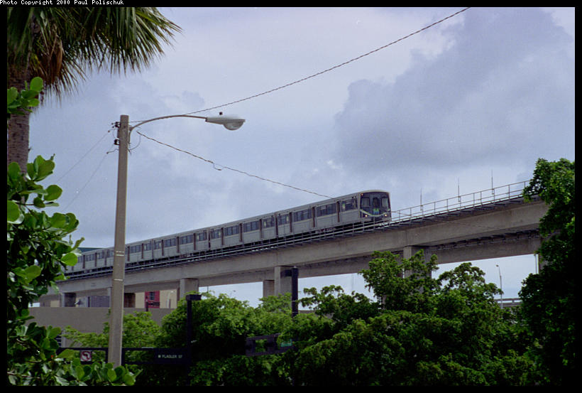(82k, 820x553)<br><b>Country:</b> United States<br><b>City:</b> Miami, FL<br><b>System:</b> Miami Metrorail<br><b>Location:</b> Government Center <br><b>Photo by:</b> Paul Polischuk<br><b>Date:</b> 8/2000<br><b>Notes:</b> View from street of northbound train<br><b>Viewed (this week/total):</b> 2 / 4436