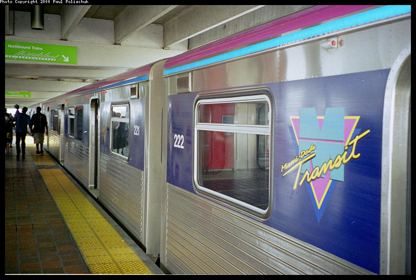 (91k, 820x553)<br><b>Country:</b> United States<br><b>City:</b> Miami, FL<br><b>System:</b> Miami Metrorail<br><b>Location:</b> Government Center <br><b>Photo by:</b> Paul Polischuk<br><b>Date:</b> 8/2000<br><b>Notes:</b> Metrorail train with new paint scheme<br><b>Viewed (this week/total):</b> 2 / 6050