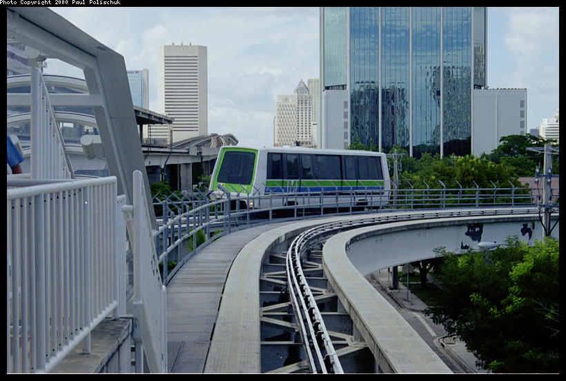 (95k, 820x553)<br><b>Country:</b> United States<br><b>City:</b> Miami, FL<br><b>System:</b> Miami Metromover<br><b>Location:</b> Brickell <br><b>Photo by:</b> Paul Polischuk<br><b>Date:</b> 8/2000<br><b>Notes:</b> Outbound Brickell train just north of Brickell Station.<br><b>Viewed (this week/total):</b> 3 / 4178