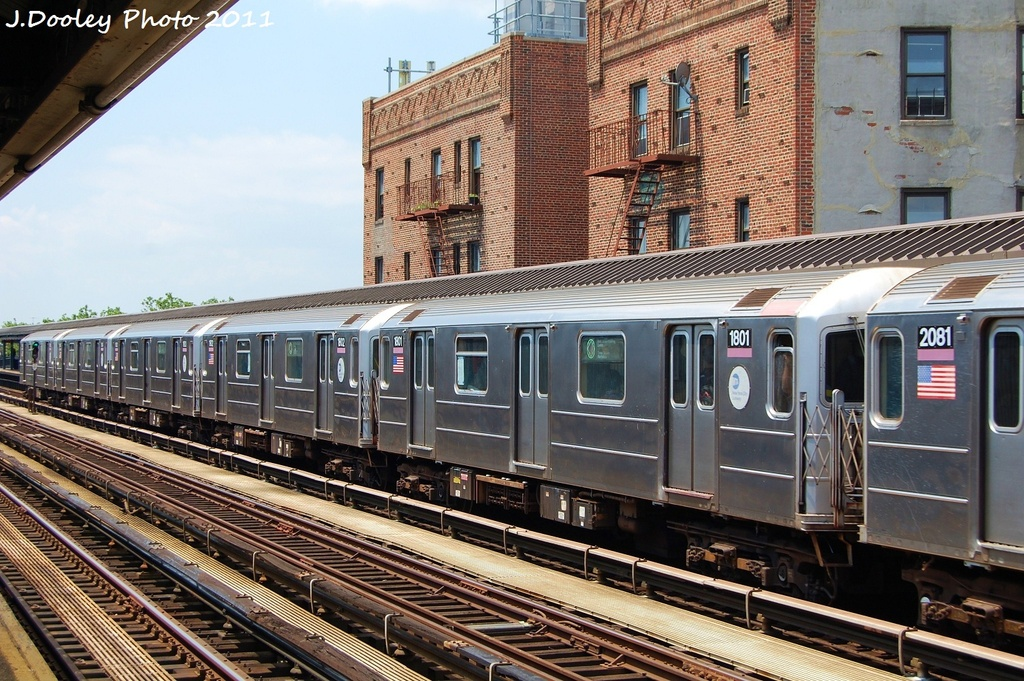 (392k, 1024x681)<br><b>Country:</b> United States<br><b>City:</b> New York<br><b>System:</b> New York City Transit<br><b>Line:</b> IRT Flushing Line<br><b>Location:</b> 52nd Street/Lincoln Avenue <br><b>Route:</b> 7<br><b>Car:</b> R-62A (Bombardier, 1984-1987)  1801 <br><b>Photo by:</b> John Dooley<br><b>Date:</b> 6/27/2011<br><b>Viewed (this week/total):</b> 8 / 430