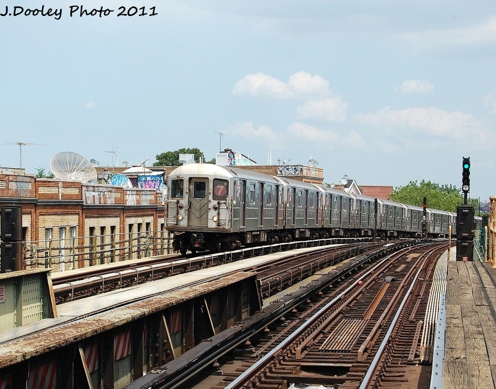 (415k, 1024x803)<br><b>Country:</b> United States<br><b>City:</b> New York<br><b>System:</b> New York City Transit<br><b>Line:</b> IRT Flushing Line<br><b>Location:</b> 52nd Street/Lincoln Avenue <br><b>Route:</b> 7<br><b>Car:</b> R-62A (Bombardier, 1984-1987)  1815 <br><b>Photo by:</b> John Dooley<br><b>Date:</b> 6/27/2011<br><b>Viewed (this week/total):</b> 3 / 816