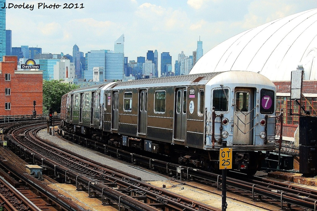 (445k, 1024x681)<br><b>Country:</b> United States<br><b>City:</b> New York<br><b>System:</b> New York City Transit<br><b>Line:</b> IRT Flushing Line<br><b>Location:</b> 33rd Street/Rawson Street <br><b>Route:</b> 7<br><b>Car:</b> R-62A (Bombardier, 1984-1987)  1990 <br><b>Photo by:</b> John Dooley<br><b>Date:</b> 6/27/2011<br><b>Viewed (this week/total):</b> 2 / 351