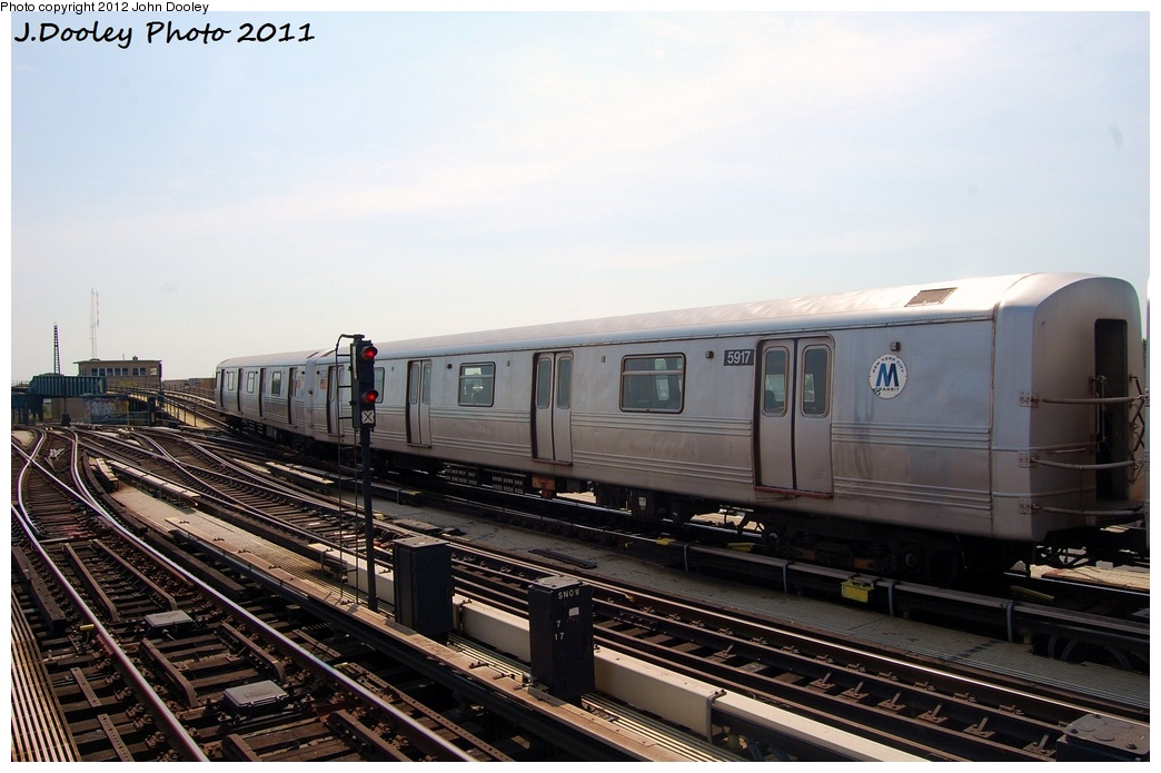 (283k, 1044x695)<br><b>Country:</b> United States<br><b>City:</b> New York<br><b>System:</b> New York City Transit<br><b>Line:</b> IND Fulton Street Line<br><b>Location:</b> Rockaway Boulevard <br><b>Route:</b> A<br><b>Car:</b> R-46 (Pullman-Standard, 1974-75) 5917 <br><b>Photo by:</b> John Dooley<br><b>Date:</b> 7/23/2011<br><b>Viewed (this week/total):</b> 2 / 382