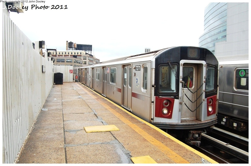 (295k, 1044x691)<br><b>Country:</b> United States<br><b>City:</b> New York<br><b>System:</b> New York City Transit<br><b>Line:</b> IRT Flushing Line<br><b>Location:</b> Court House Square/45th Road <br><b>Route:</b> Testing<br><b>Car:</b> R-188 (R-142A Conversion, Kawasaki, 1999-2002) 7271 <br><b>Photo by:</b> John Dooley<br><b>Date:</b> 9/20/2011<br><b>Notes:</b> R-188 CBTC conversion test train.<br><b>Viewed (this week/total):</b> 1 / 809
