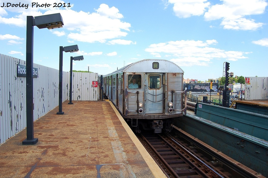 (345k, 1024x680)<br><b>Country:</b> United States<br><b>City:</b> New York<br><b>System:</b> New York City Transit<br><b>Line:</b> IND Fulton Street Line<br><b>Location:</b> Rockaway Boulevard <br><b>Route:</b> A<br><b>Car:</b> R-32 (Budd, 1964)  3353 <br><b>Photo by:</b> John Dooley<br><b>Date:</b> 8/11/2011<br><b>Viewed (this week/total):</b> 0 / 613
